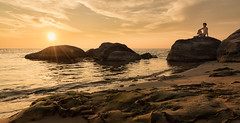 Relaxing on the rocks (languitar) Tags: rock sitting sand sunset water surf vietnam rocks sun beach ocean longbeach ray wave people phuquoc coast cliff sea phquc socialistrepublicofvietnam vitnam tpphquc tnhkingiang vn