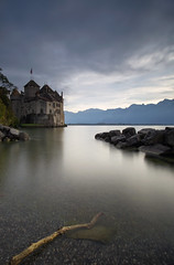 Château de Chillon (Philippe Saire || Photography) Tags: canon eos 5d mark iii ef 1740mm f4l usm nature paysage landscape architecture château castle chillon suisse switzerland swiss lac lake léman eau water wideangle vieux old ancien chablais montagne mountain alpes alps jetée shore pierre rock rocher sky nuages clouds long exposure hoya nd400 cokin p121m gnd4 fullframe ff pleinformat philippesaire explore schweiz photo photography ciel