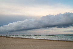 Low Clouds (Leonardo Caggianelli) Tags: sea sky italy cloud beach rain clouds landscape italia samsung marche samsungnx samsungnx3000