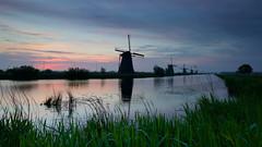 Vroege ochtend in Kinderdijk (zsnajorrah) Tags: trees sky reflection nature water netherlands windmill silhouette clouds rural sunrise canal dusk bluehour kinderdijk alblasserdam 7dmarkii efs1018mm