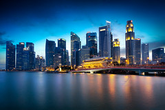 Singapore city (Patrick Foto ;)) Tags: city travel bridge blue light sea sky urban panorama reflection building tower tourism water skyline architecture modern night skyscraper marina river landscape outdoors evening bay singapore asia downtown cityscape exterior waterfront view riverside dusk district space famous central landmark center scene structure illuminated business commercial metropolis concept sg financial copy