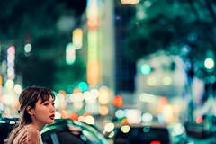 Spacing Out In Shibuya (Jon Siegel) Tags: city urban woman girl japan night japanese tokyo nikon bladerunner bokeh space 14 shibuya 85mm nikkor nikon85mmf14 d810