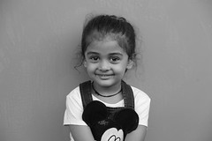 Stars in her eyes (Rahul Gaywala) Tags: black candid child girl happy lovely mono monochrome portrait smile star street sweet twinkle white