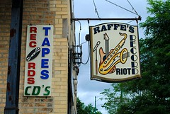 Raffe's Record Riot (Cragin Spring) Tags: city urban music usa chicago records sign store illinois midwest unitedstates guitar unitedstatesofamerica chitown il plastic saxaphone northside tapes chicagoillinois chicagoil windycity portagepark raffesrecordriot