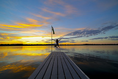 Jump! (Mercenaryhawk) Tags: life blue sunset summer sky woman lake 3 reflection water up minnesota yellow clouds canon eos jumping dock cabin mark iii north vivid sunsets round 5d 28 northern mn cabins bigfork 14mm rokinon nashwauk