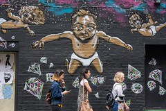 Cherubs Bearing Gifts (Silver Machine) Tags: london streetphotography street candid girls graffiti walking goldencherubs diamonds goldenbabydiamonds wall fujifilm fujifilmxt10 fujinonxf35mmf2rwr