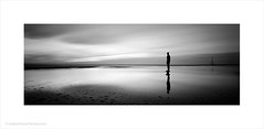 Another Place (Andrew James Howe) Tags: longexposure light sea england sky blackandwhite reflection clouds liverpool reflections landscape mono nikon iron dusk fineart drama beech crosby antonygormley merseyside anotherplace andrewhowe