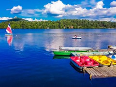 Summer of colors (suspiciously conspicuous) Tags: trees summer usa lake newyork water clouds reflections landscape boats us mirrorlake adirondacks northamerica newyorkstate lakeplacid adirondackpark