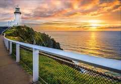 Sunrise at Cape Byron (Elephas_a) Tags: ocean morning pink blue sea sky orange lighthouse beach water yellow clouds sunrise landscape dawn coast australia landmark pacificocean shore nsw newsouthwales coastline byronbay goldenhour waterscape capebyron seascepe