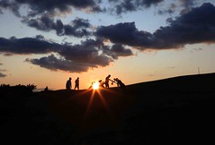 Last hole of the day (Jo Evans1 - on catch up) Tags: sunset last golf three day hole cliffs course sunburst silhouetted golfers pennard