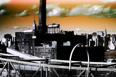 Fallen Domino (mheidelberger2000) Tags: city newyorkcity red sky urban plant skyline architecture brooklyn clouds outside experimental manhattan williamsburg empirestatebuilding chryslerbuilding refinery williamsburgbridge dominosugar