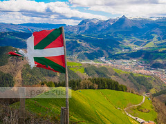Basque country flag Txindoki mountain on sunny day (Pere Rubi) Tags: alone basque beasain beautiful beauty blue city climb clouds country culture day destination destiny enjoy environmental flag green high holiday horizon landscape light mountain natural nature outdoor paradise relax rock rough scenic sky skyline snow spain sport stone summer sun sunlight sunny tourism touristic town travel tree txindoki vacation