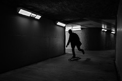 Tunnel (johnjackson808) Tags: people blackandwhite bw monochrome silhouette vancouver streetphotography tunnel skateboard fujifilmxt1 southgranvillest