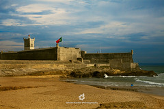 Forte de So Julio da Barra, Carcavelos (fesign) Tags: sea sky history beach portugal nature horizontal architecture outdoors photography sand surf day lisbon flag watersedge fortress vacations portuguese carcavelos cloudsky traveldestinations colourimage builtstructure fortedesojuliodabarra