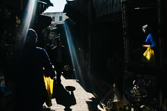 Fes, Morocco 2015 (f.d. walker) Tags: africa street blue light shadow people woman sun sunlight man color reflection men colors yellow contrast reflections shopping bag person mirror women market candid colorphotography streetphotography streetportrait naturallight clothes morocco fez medina sunrays sunray fes lightstreak candidphotography