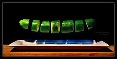 Hovering Cuke (J Michael Hamon) Tags: camera blackbackground fruit 35mm lens photography nikon widescreen cucumber floating vegetable produce trick sliced nikkor float slices tabletop hovering hover levitating levitate hamon d3200 photoborder