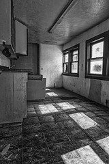 Abandonded With Nothing Left Behind Except Broken Glass And Shadows On The Kitchen Floor (Mike Schaffner) Tags: old windows blackandwhite bw house abandoned home kitchen monochrome us blackwhite texas shadows unitedstates decay brokenglass derelict urbex tomball
