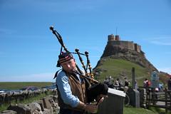 Holy Island Solo (votsek) Tags: musician scotland piper bagpipes holyisland 2016 lindisfarnecastle