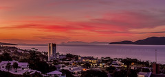 Tropical Sunset (Kent Wilkins) Tags: landscape sunset tropical ocean cityscape sun clouds buildings magnetic island townsville queensland australia