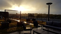 Rooftop sunset. ([Gaston].) Tags: seattle sunset rooftop rain architecture patio wallingford greenroof