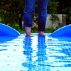 How to empty a pool (sa1_m0ne) Tags: blue reflection water memories summertime goodtimes poolparty plasticpool friendster mirroreffect wetfeet chilltime pouringout