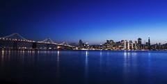 SunsetSf (idiottool) Tags: sanfrancisco city blue sunset skyline treasureisland dusk citylights baybridge yerbabuena metropolitan