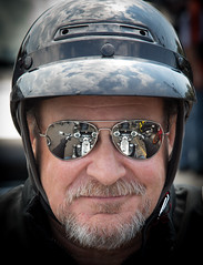 I can see it in your eyes... (QC Doc) Tags: sunglasses helmet shades motorcycle biker fridaythe13th portdover srteetphotography helmetreflections