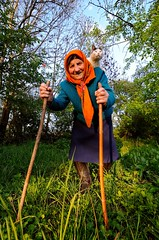DSC_9185 (klakeduker) Tags: world old trees portrait orange pet sun face grass scarf cat spring village grandmother may age figure welcome womans