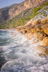 Waves (aleksey_kondratiev) Tags: turkey fethiye oludeniz mediterranean sea water blue wave waves seashore rocks sky mountain
