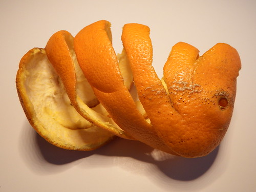 From flickr.com: Peeling an orange in one piece {MID-155814}