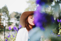 Blue Flowers (Yuliya Bahr) Tags: park flowers blue portrait woman girl beautiful beauty face hat germany garden bokeh hamburg plantenunblomen closedeyes fotografberlin fotografhamburg