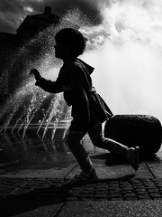 Happiness (Streets of Nuremberg) Tags: sky blackandwhite bw fountain girl monochrome juni clouds munich blackwhite brunnen streetphotography dramatic thunderstorm schwarzweiss playful mdchen backlighting stachus karlsplatz 2016 streetfotografie ricohgrii strasenfotografie streetsofnuremberg stonurontheroad