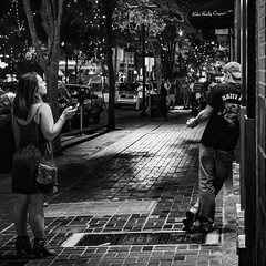 Night Watch (Tom Frundle) Tags: street city people woman man streets guy girl night square downtown nashville citylife streetphotography streetscene nightscene nightlife bnw nashvilletn nashvegas musiccity nashvilletennessee downtownnashville rsastreet