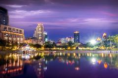 Cityview From Benjasiri Park, Bangkok (Iftakhar Hasan) Tags: park longexposure sunset reflection canon thailand asia bangkok citylights bluehour benjasiripark canoneos7d benchasiripark iftakharhasan canonefs1018mmf4556isstm