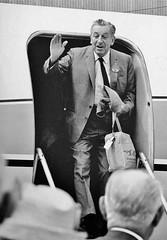 Walt exiting plane