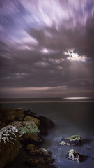 Lightness of Meloncholy (reflectioninapool) Tags: ocean longexposure sky moon seascape lightpainting motion blur color beach gulfofmexico nature water stone night clouds dark stars outdoors us rocks unitedstates florida jetty bould