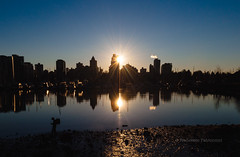 Sunset Glory (Francesco Patroncini Photography) Tags: blue light sunset sky water skyline vancouver reflections nikon tramonto skyscrapers dusk symmetry stanleypark flares crepuscolo d90 nikond90
