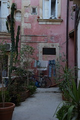 Hello. (-Chiallonz) Tags: ortigia italy island sicily sicilia siracusa syracuse journey vanaces summer holiday allaperto coutryard bicycle blue pink house