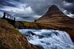 walk on by (gregor H) Tags: bridge people mountain cold water silhouette landscape waterfall iceland couple stream cloudy hiking sparkle clear human rainy pure kirkjufell slope tingle kirkjufellfoss