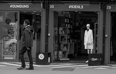 Dum Dums in one door and Kiehls in the other (janewynyard) Tags: streetphotography streetlife londonstreetphotography skeleton bricklane blackandwhite blackandwhitephotography bones kiehls dumdums