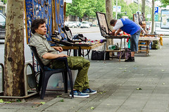 173/365 (goran1101) Tags: street city people man 35mm nikon candid nikkor streetseller d5100