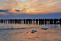 ondergaande zon aan zee (Omroep Zeeland) Tags: natuur zeeland zee zon vlissingen walcheren ondergaande nollestrand paalhoofd