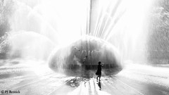 Circle of Light (PJ Resnick) Tags: pjresnick perryjresnick pjresnickgmailcom pjresnick fujinonxf35mmf14r 35mm xf35mmf14 fujinon xf light fuji fujifilm noir atmosphere atmospheric digital shadow texture shadows wa washington angle perspective resnick simple gray grey blackandwhite monochrome monochromatic rectangle rectangular bw mono black white water structures outdoor xpro2 fujifilxpro2 seattlecenter fountain animalia spray mist acros acrosg girl woman highlights fujilove 2016fujiloveglobalphotowalk fujiloveglobalphotowalk whitewall