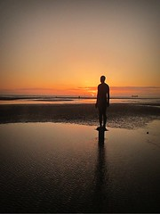 Another Place (mr_snipsnap) Tags: sunset sculpture orange reflection art beach water silhouette liverpool antony gormley crosby merseyside