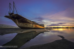 Stranded at Sunsets (Rafie Rosli Putra) Tags: longexposure bridge photography ship sunsets fav wreck hdr singleraw rafierosliputra johorstudio