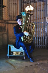 Flaming horn (jeremyhughes) Tags: street city urban musician music london public 50mm glasses nikon flames sigma suit entertainment flame tophat entertainer busker horn performer brass busking flaming northumberlandavenue tails playhousetheatre windinstrument pincenez d700