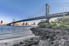 The Manhattan Bridge from the Shores of Brooklyn, New York (D200-PAUL) Tags: newyorkcity newyork brooklyn manhattanbridge eastriver empirestatebuilding empirestate canalstreet flatbushavenue washingtonstreet washingtonst bridgemanhattan jameswarren leonmoisseiff warrentruss josefmelan paulfernandez