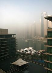 Foggy morning - Dubai Marina, UAE (kadryskory) Tags: city trip urban cloud water fog marina buildings boat dubai skyscrapers uae foggy yachts dubaimarina tarvel kadryskory