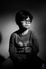 Sitting still (ileset) Tags: boy portrait hardlight