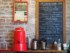 Clementine's Cafe (JenxAmanda) Tags: man color cute male coffee colors brooklyn vintage cozy vegan cafe small hipster olympus adventure explore blonde espresso lovely dslr chalkboard olympuspen hdr bedstuy aesthetic olympusomd